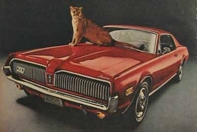 A red Mercury Cougar automobile.