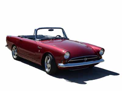 A deep red Sunbeam Tiger